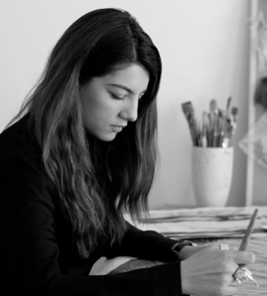 Creative Director and artist, Gyunel at work in her London-based atelier.
