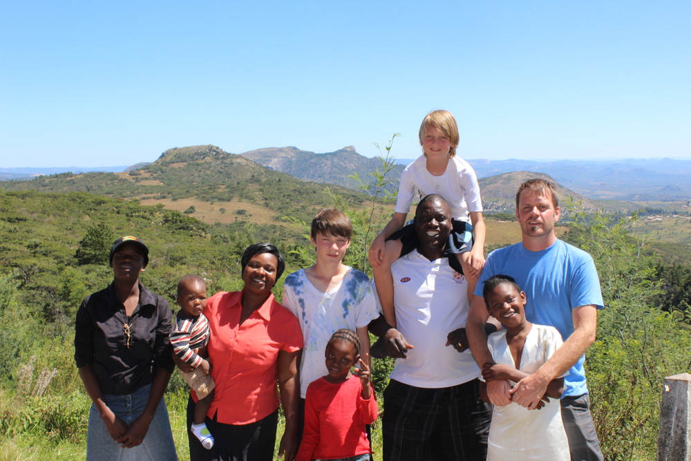 Our family with our host family, Farai and Mildred and their kids...who shared their home with us for a month.