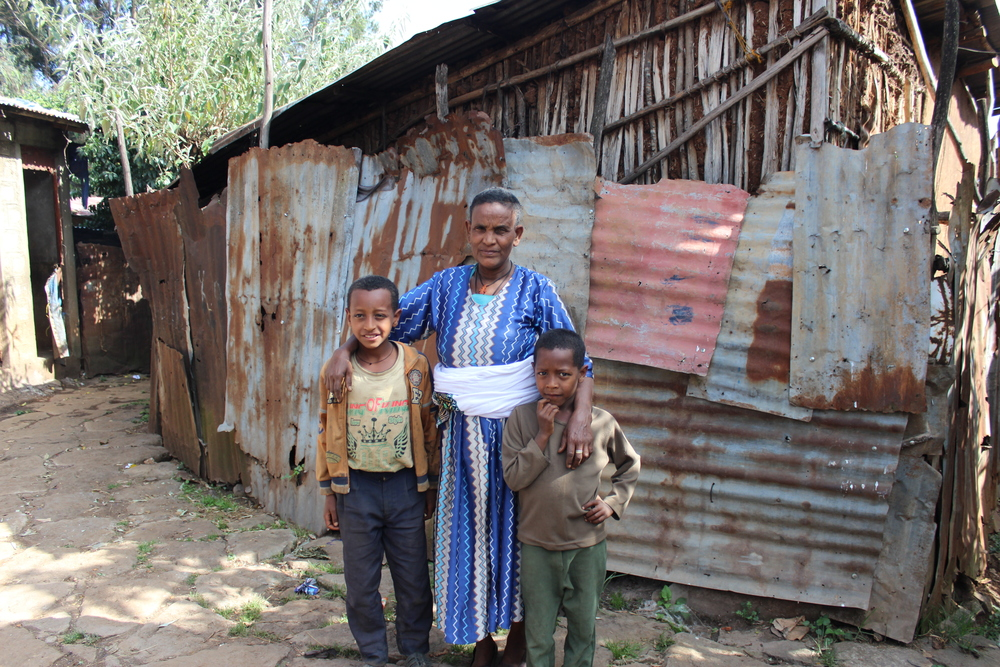 A grandmother raises her two grandsons near Kality, in this shelter which houses four families.