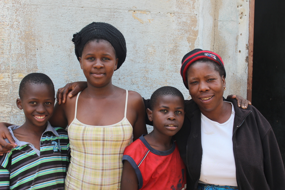 "Kdaushe, Wedzenai, Nsimba and their care worker - ""Mama"" Rhoda."