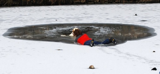 Notice that the lady is starting to go through the ice.