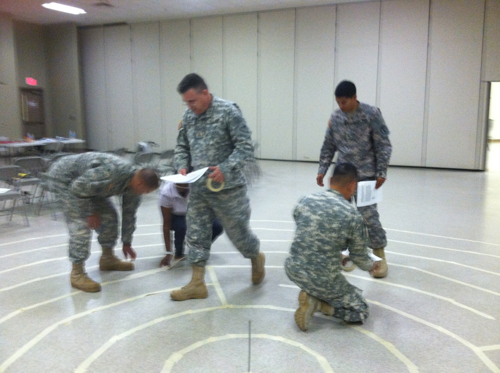 Chaplains and social workers construct a labyrinth at Fort Benning