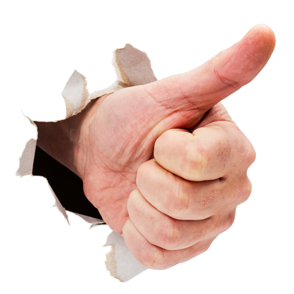 Thumbs up hand sign breaking through thorn paper isolated on white.