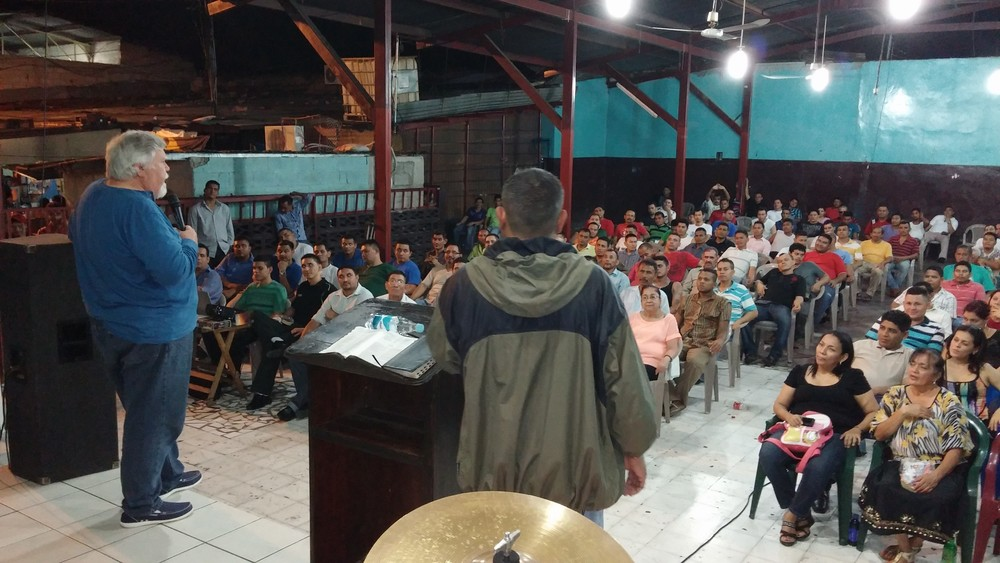 Johnny preaching in a prison in Honduras.jpg