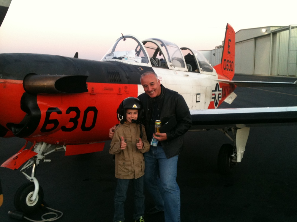 "Mike Arcadi, who recently rejoined Elite Air as a Lear 31 pilot, said his son ""is the proudest accomplishment of [his] life and one of the few people who can get [him] in a picture."""