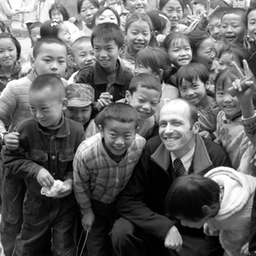 surrounded by children in tianquan.jpg