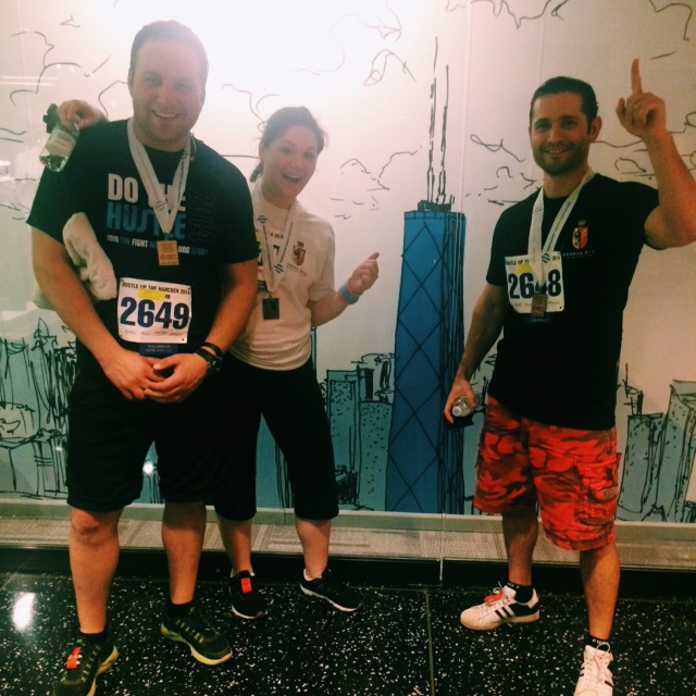 Gene Leykind. Rachel Leykind. Leonard Goldberg. After a grueling 94 floor climb, the trio looked as happy as can be.