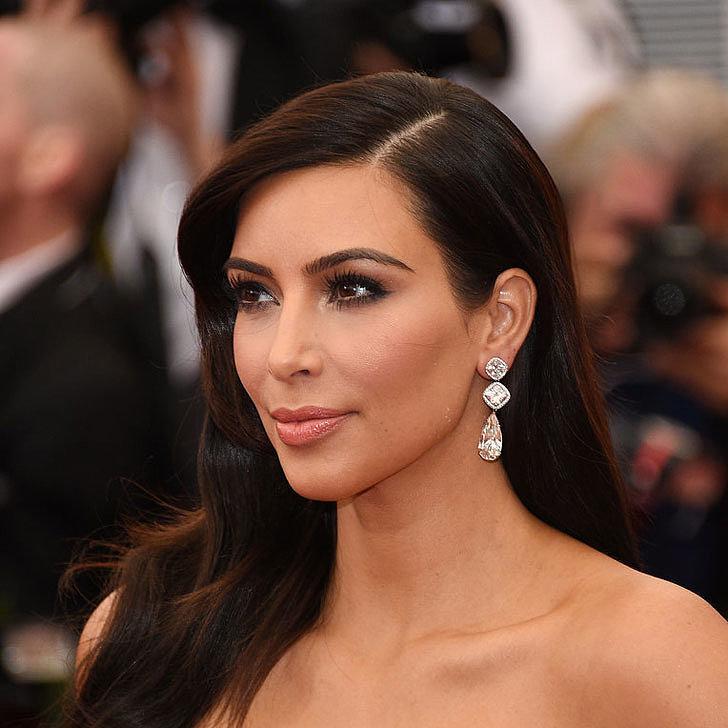 Kim Kardashian kept it simple and elegant in her diamond earrings.
