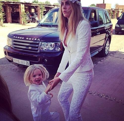 Cara resumed her role as bridesmaid and babysitter in a white lace Pucci suit.