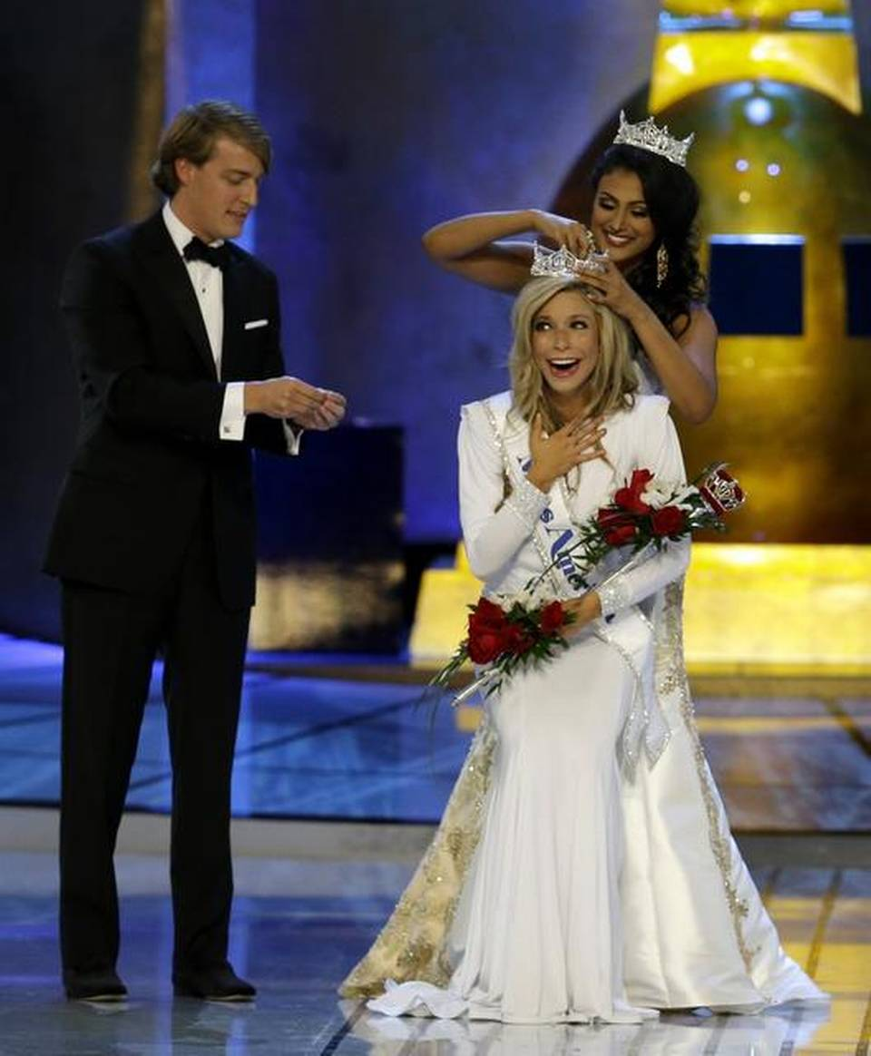 Miss America 2014 Nina Davuluri, top right, crowns Miss New York Kira Kazantsev as Miss America 2015 during the Miss America 2015 pageant, Sunday, Sept. 14, 2014, in Atlantic City, N.J. (AP Photo/Mel Evans)
