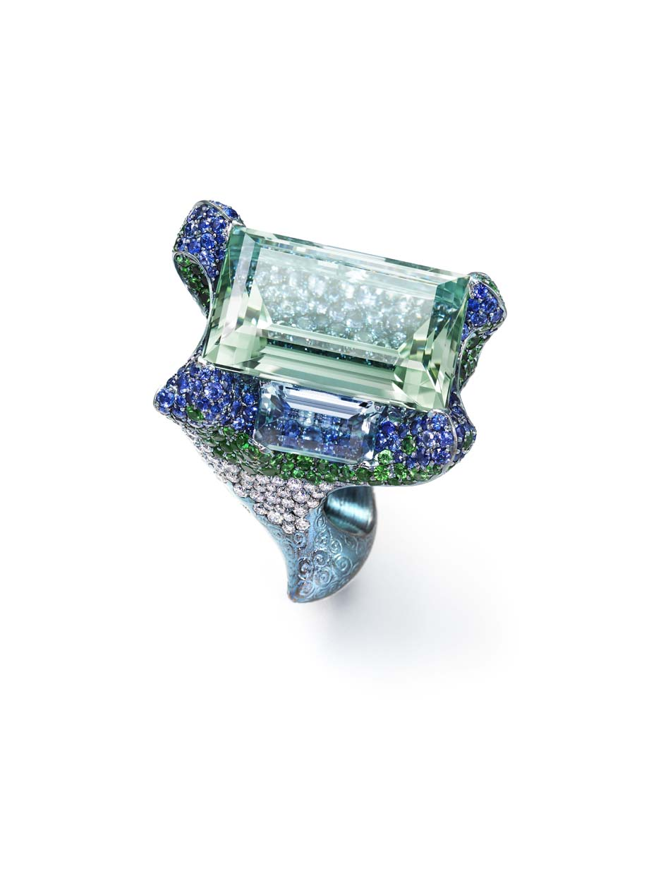 Wallace Chan Cloudless Climes ring set with a central 31.13ct aquamarine and two additional aquamarines, diamonds, tsavorites, garnets and sapphires.