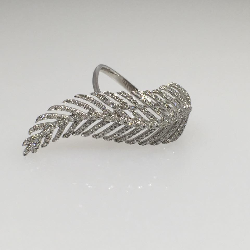 18 Karat White Gold Feather Ring. Diamonds: .57 cts
