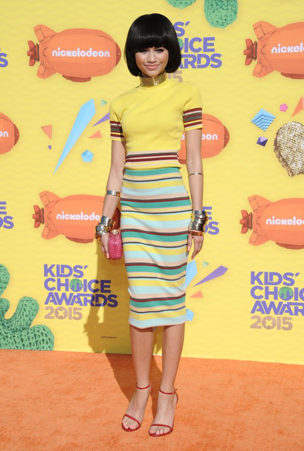 Zendaya  made her triumphant return to the red carpet after the infamous Oscars   controversy surrounding Giuliana Rancic's  comments, the 18-year-old was all smiles in a colorful and sporty striped DKNY dress and a cute bob hairstyle.