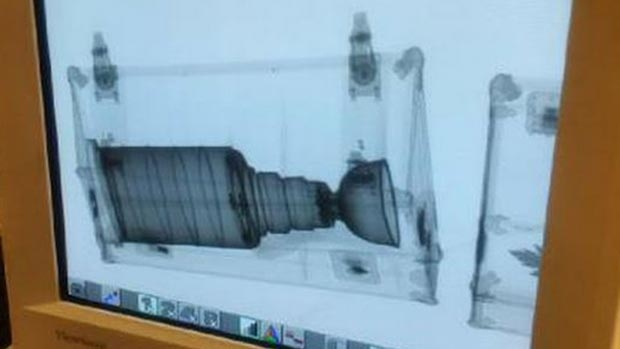 The Stanley Cup goes through the X-ray process before taking flight to Chicago.