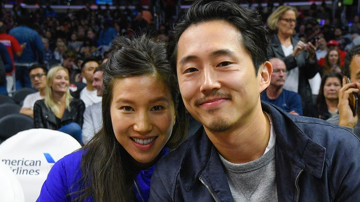 Steven Yeun (R) and Joana Pak attend a basketball game between the Detroit Pistons and the Los Angeles Clippers at Staples Center on November 7, 2016 in Los Angeles, California.   Credit: Noel Vasquez/GC Images