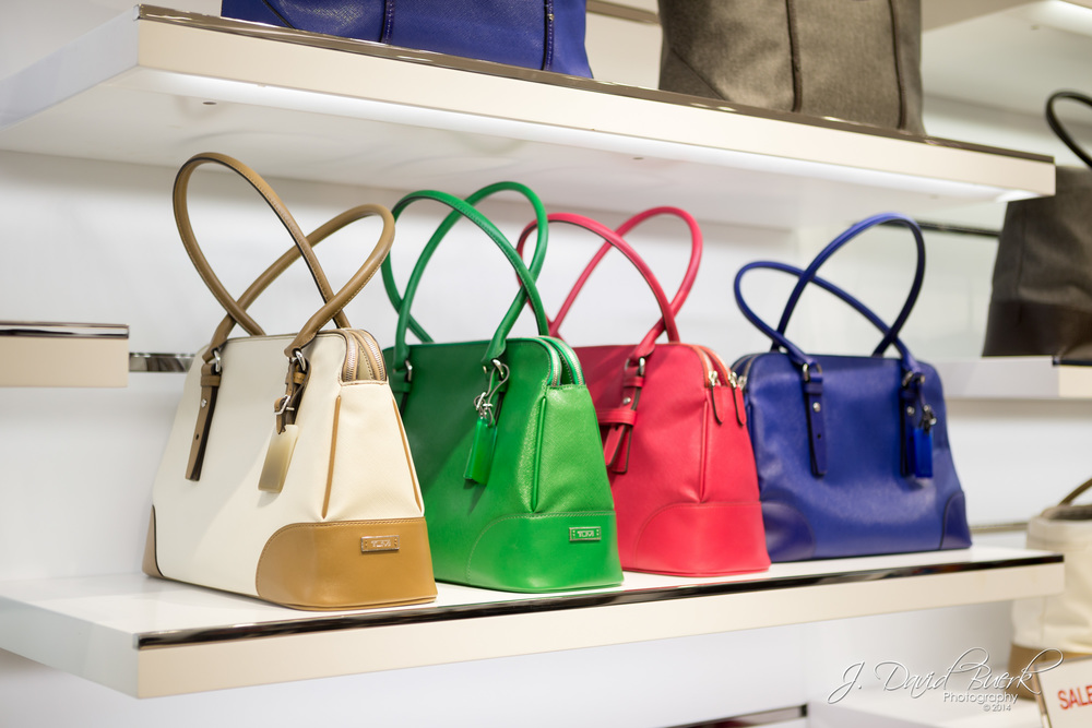 Women's handbags inside Washington Dulles International Airport's Tumi.