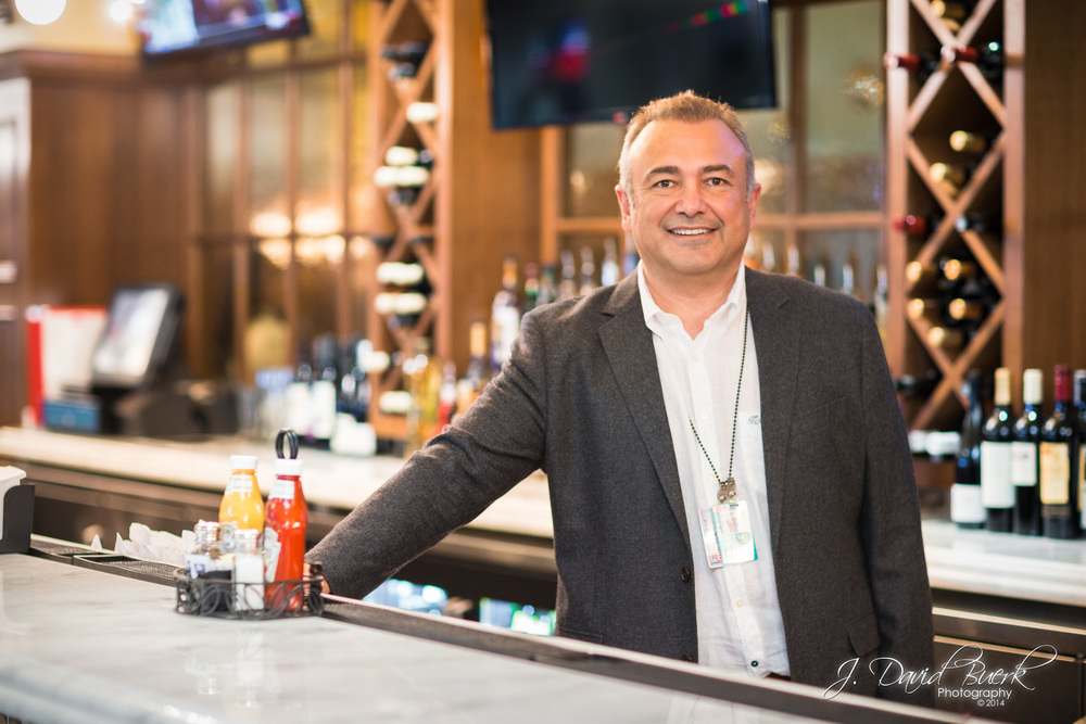 Hakan Ilhan, owner of Bistro Atelier at Washington Dulles International Airport, stands behind the bar on the first day of serving the Washington region's travelers.