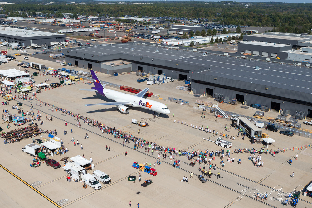 An aerial photograph of participants pulling a FedEx 757 during the 2014 Dulles Day Plane Pull and 5K / 10K on the Runway.