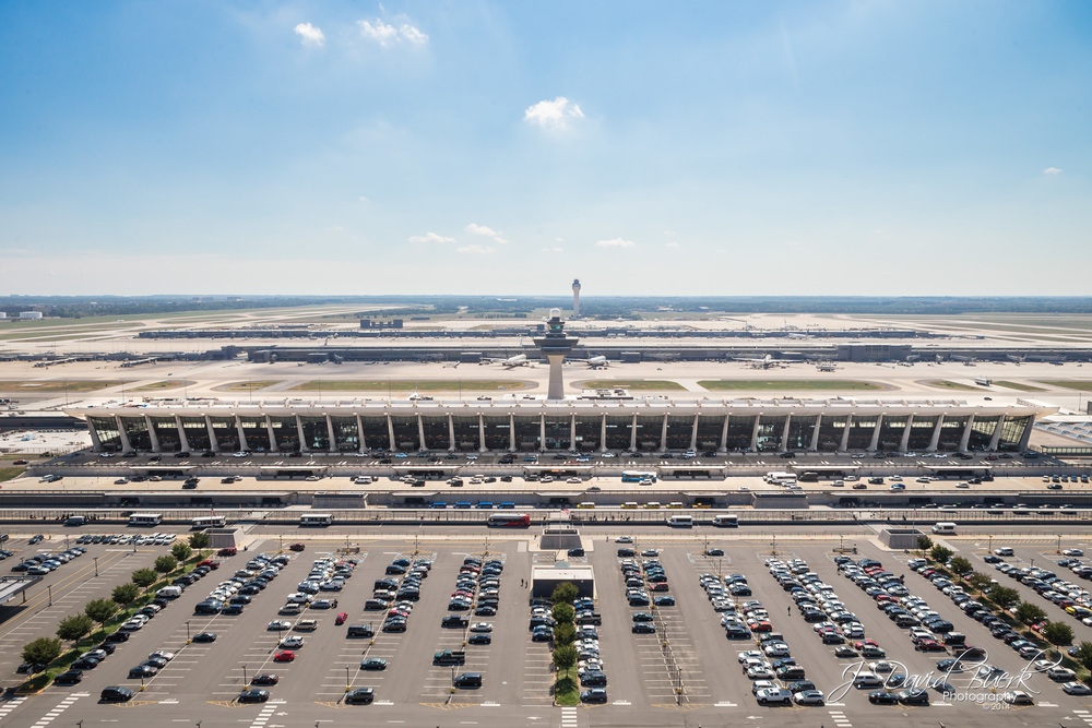 An aerial photograph of Washington Dulles International Airport's historic Main Terminal Building.