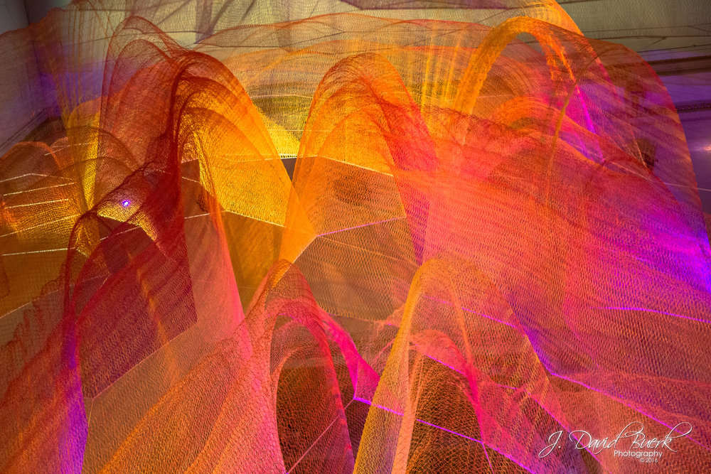Janet Echelman's 1.8 Renwick at the Renwick Gallery of the Smithsonian American Art Museum.  This photograph of Echelman's woven sculpture is displayed upside down to create additional dramatic discord and illusion to the already intricate landscape of mesh.