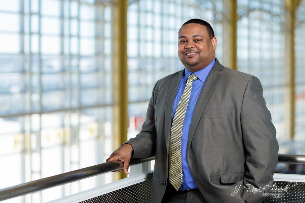 Portrait of Sidney Woods, Marketing Director at Washington Dulles International Airport, photographed in Ronald Reagan Washington National Airport's Main Terminal.