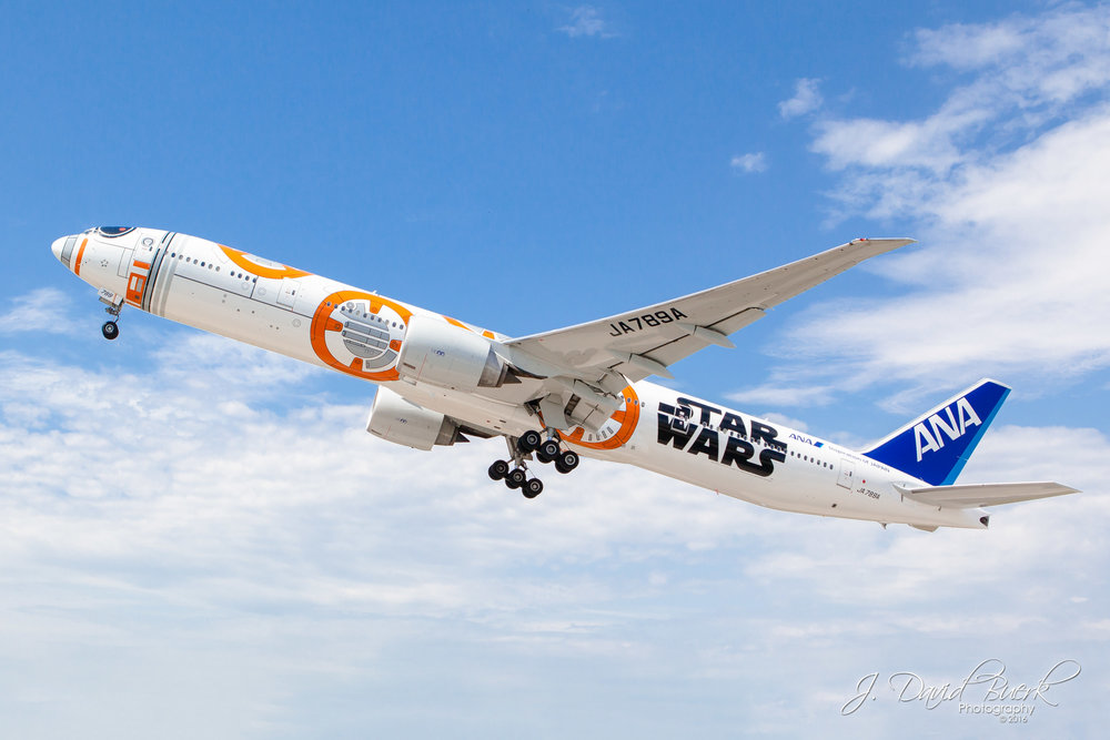 "All-Nippon Airways' ""BB-8""  Star Wars  777 departing Washington Dulles International Airport after a promotional visit by the aircraft.  The Metropolitan Washington Airports Authority held a Discover Dulles event to mark the occasion, welcoming 50 lucky participants to watch the aircraft's arrival on the runway itself, and providing a tour of Airport Operations and Dulles' Ramp Tower."