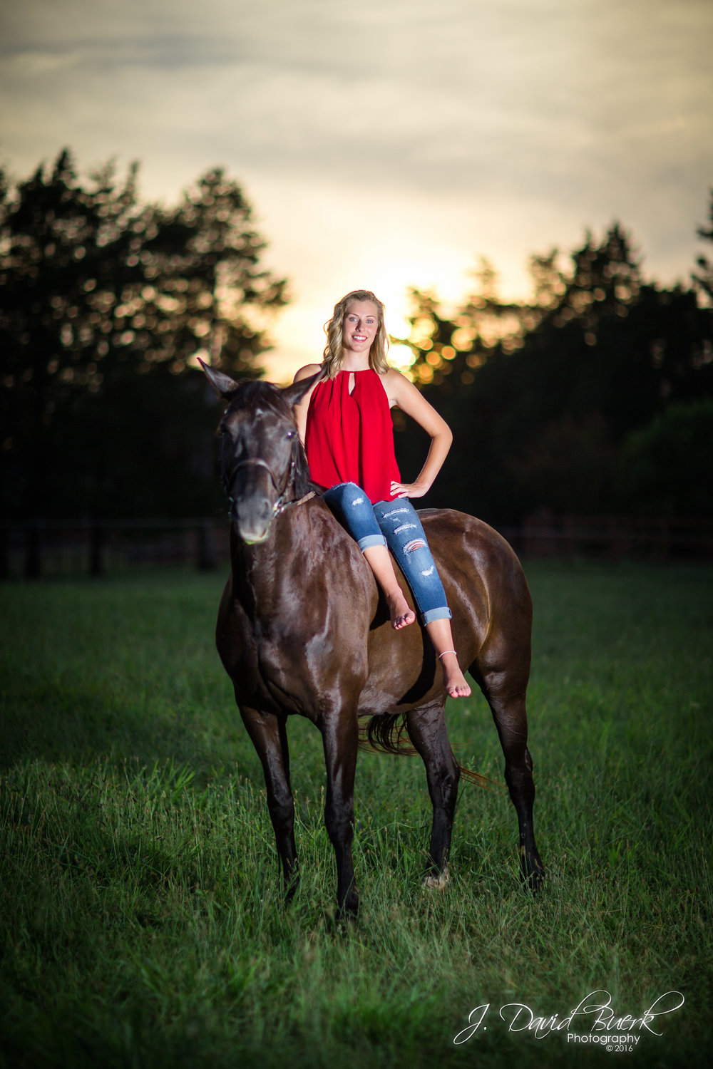 Portrait of Savannah, a rising high school senior, Class of 2017, photographed at her stable where she cares for her horse Tosca, and trains with him for equestrian events.