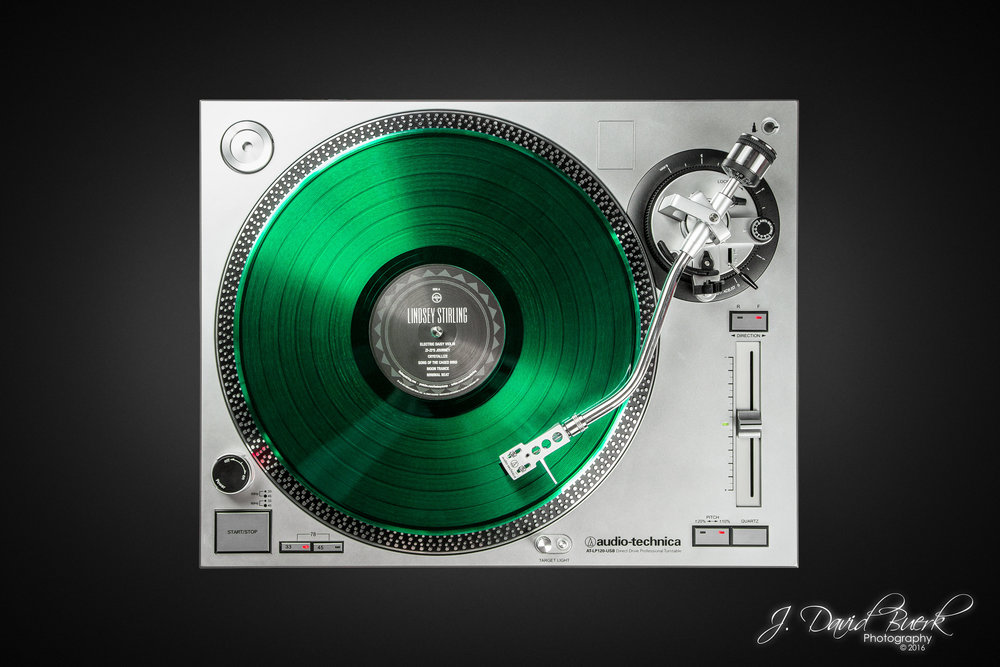 A Translucent Green Lindsey Stirling eponymous LP 33 RPM vinyl on an Audio-Technica turntable.