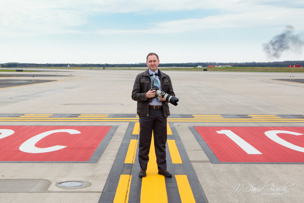 "J. David Buerk, Washington, DC area commercial photographer, on Washington Dulles International Airport's R/W 1C high-speed hold-short line while photographing on assignment for the Metropolitan Washington Airports Authority during the All-Nippon Airways' ""BB-8"" Star Wars 777 event.  Photo edited by J. David Buerk."