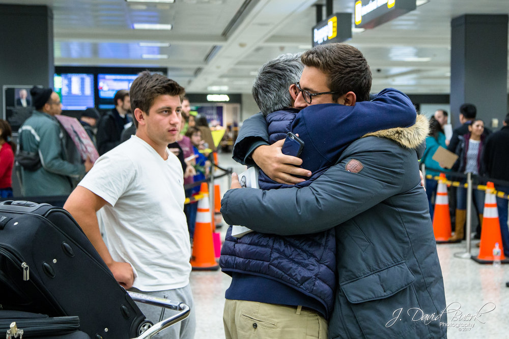 Reunions upon clearing customs are often emotional regardless of residency, citizenship, and immigration status.