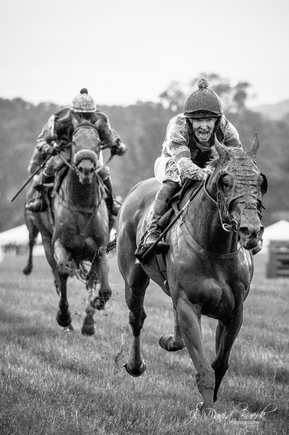 Jockies on the main straightaway approach the finish line at the Virginia Gold Cup.  2017 hosted one of the rainiest, muddiest Gold Cups of recent history.