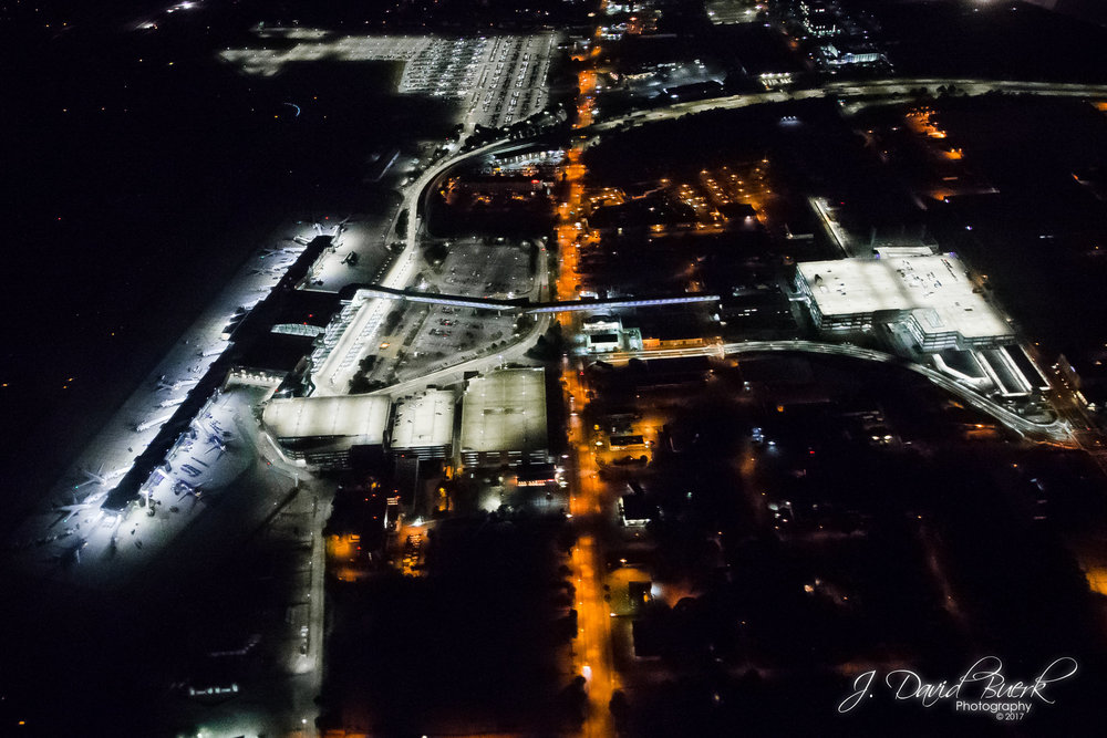 A nighttime aerial image of T. F. Green Airport in Rhode Island.