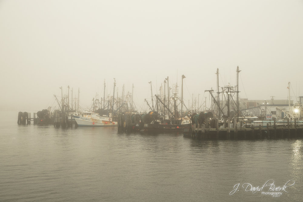 Fishing vessels docked at Galilee Salt Pond Harbor in Narragansett, Rhode Island.