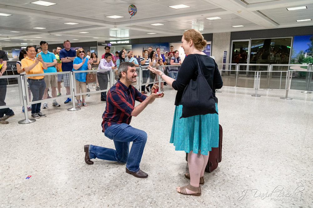 Bayard proposes to Margaret upon her arrival and clearance through Customs at Washington Dulles International Airport.