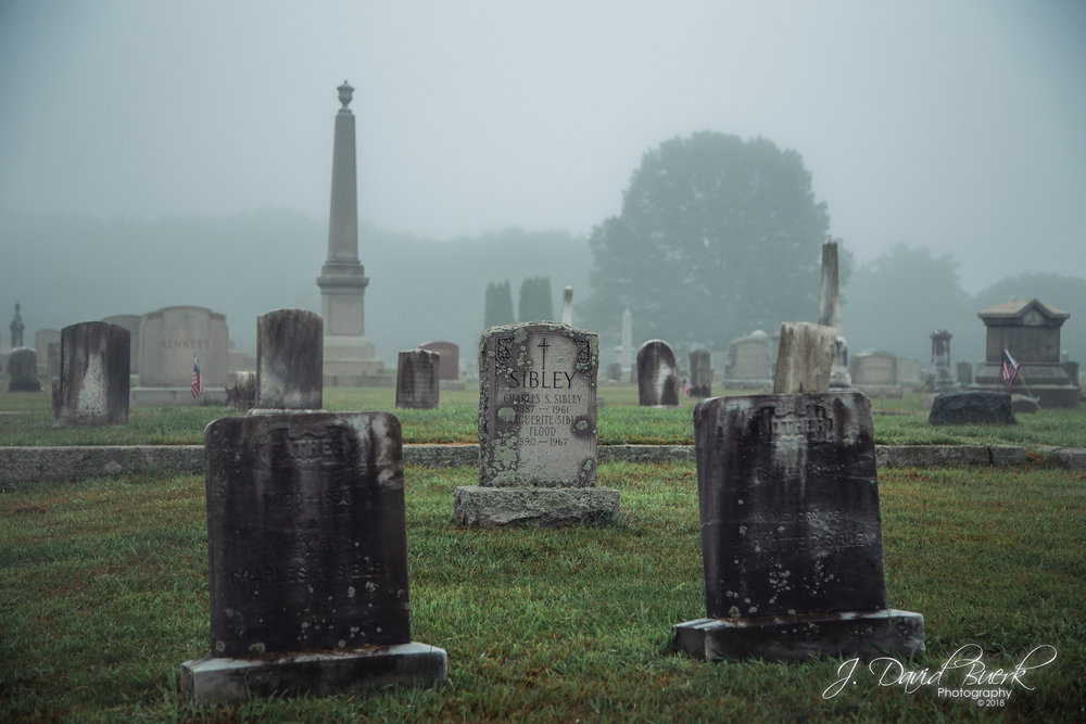 Headstones in the fog, seen in Union Cemetery, North Smithfield, Rhode Island.