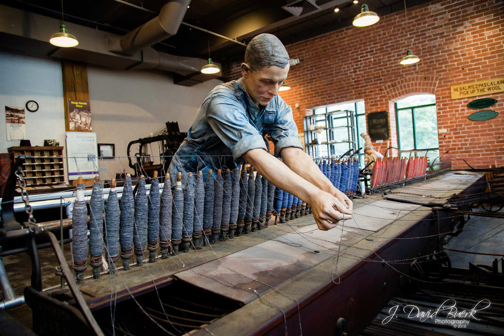 At the Museum of Work and Culture in Woonsocket, Rhode Island, a French-Candian immigrant worker tends to a loom.