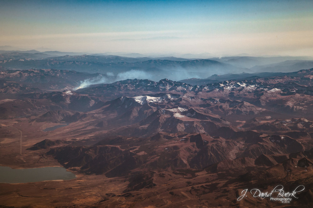 Aerial view of wildfire in the Sierra Nevada mountain range.