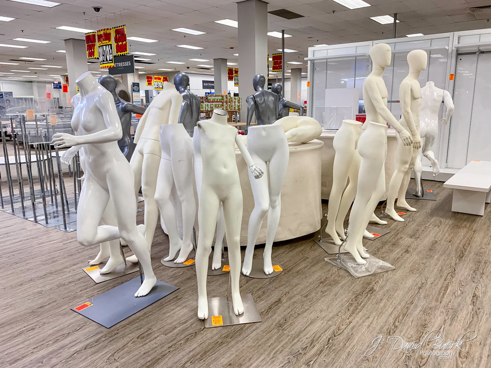 And assortment of mannequins gathered for closeout sale in a liquidating Sears department store. Shot and edited entirely on iPhone XS.