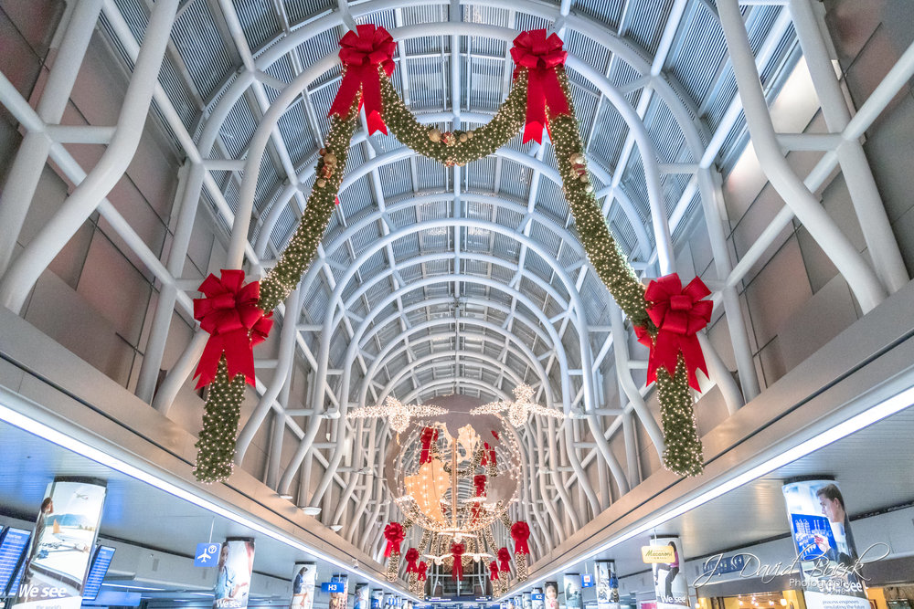 Chicago O'Hare International Airport's iconic Terminal 3 decorated for Christmas as seen in  Home Alone 2: Lost in New York .