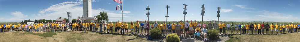 Convention attendees at Hawkeye Point, Iowa. The panorama makes it seem like they are standing in a straight line, when they are in fact encircling me.