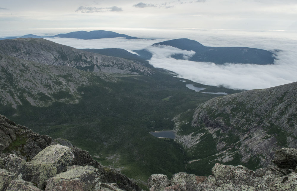 View from the summit. Chimney Pond is in the bottom middle, the Basin Ponds a little farther back, and then the fog filled lowlands.