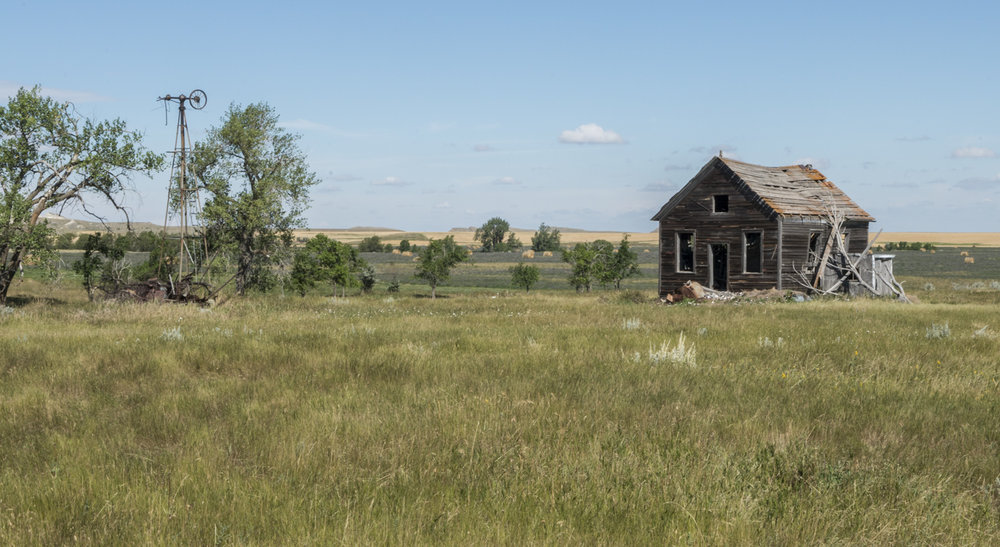 Abandoned farm house and windmill