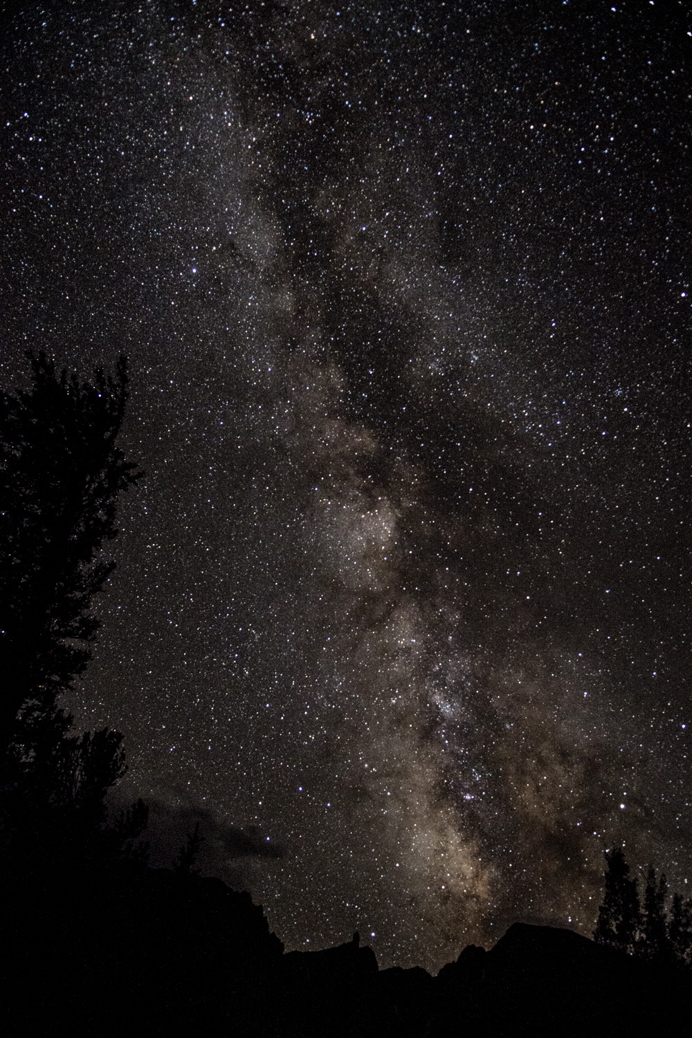 The Milky Way over Great Basin National Park. Taken from Wheeler Peak Campground at about 10,000 feet. The mountain at the lower right is Wheeler Peak.