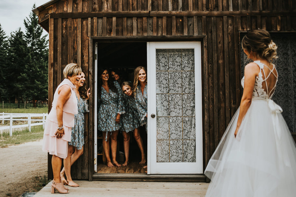 Bridesmaids first look with bride in her Blush by Hailey Paige wedding dress