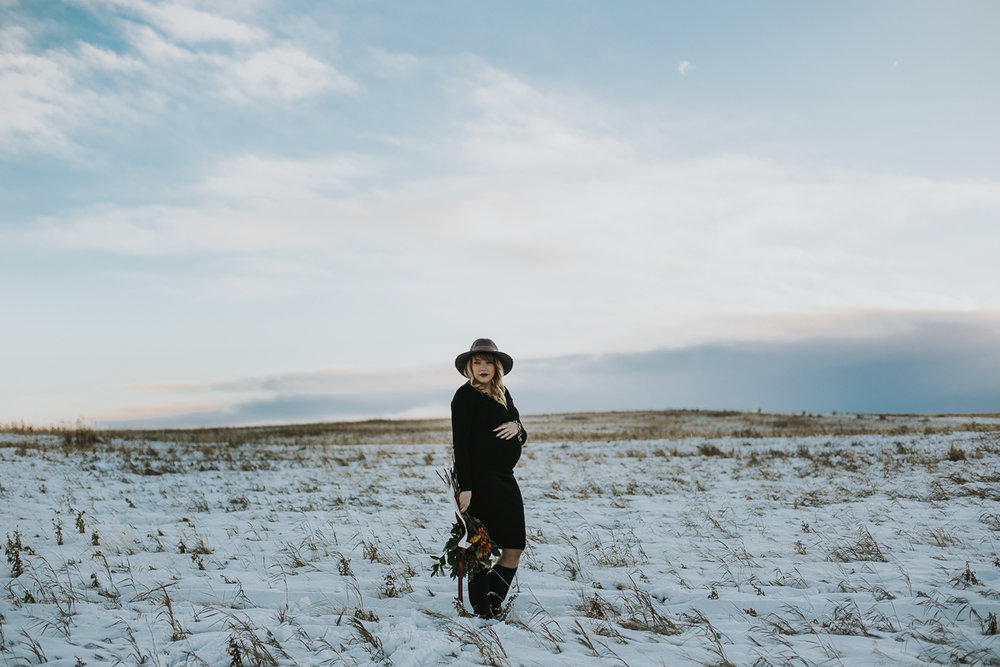 Calgary boho winter maternity session in snowy field