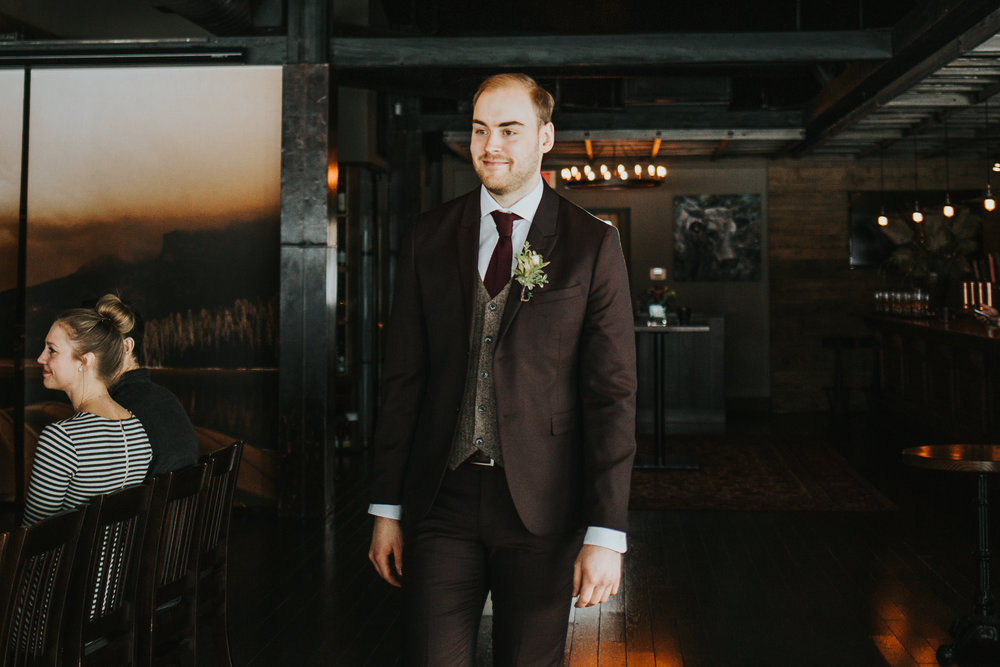 Groom walking down the aisle at Calgary Alberta The Lake House wedding