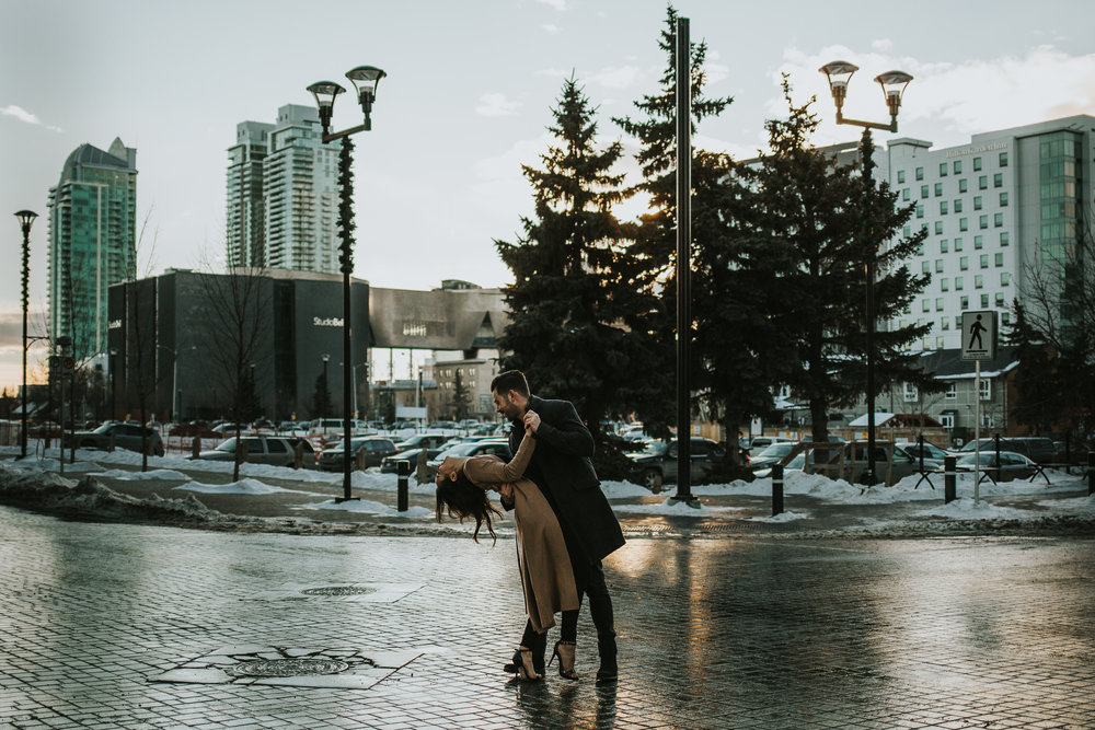 Couple dancing in the road in the East Village during their Calgary Alberta engagement session
