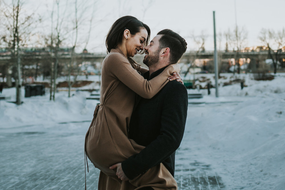 Couple snuggling nose to nose at their engagement shoot