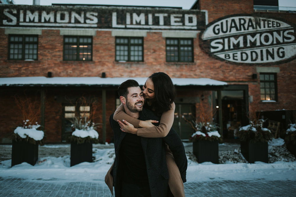 Calgary engagement photos in front of the Simmons Building