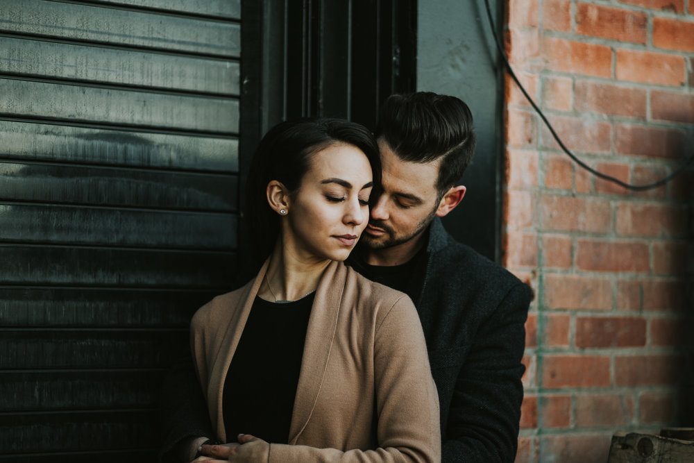 Moody engagement photos in Calgary's East Village